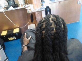 dreadlocks i did cornrowed back and some left loose
